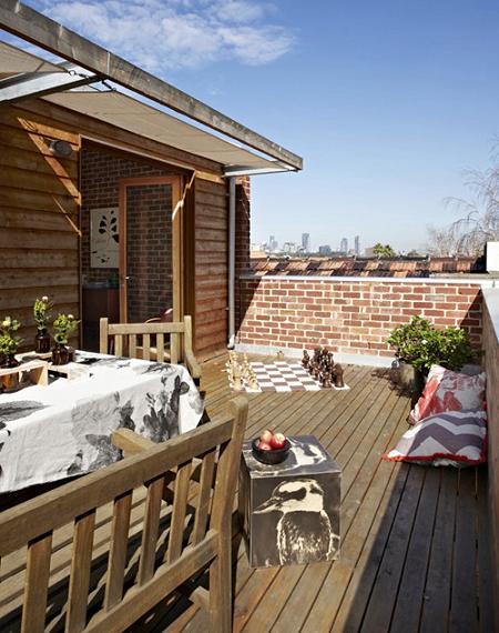 Una casa con paredes de ladrillo decoraci n - Decorar paredes de terrazas ...