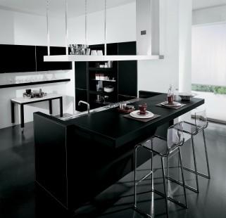 Sliding cocina completa y barra de desayunos en una isla for Cocinas modernas en espacios reducidos