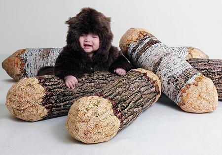 Cojín con forma de tronco
